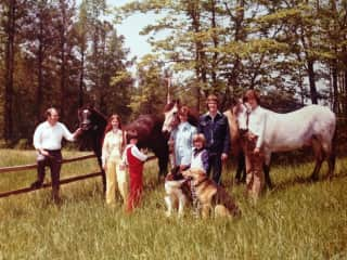 My family photo from 1975! I'm in red, holding our cat. I grew up loving all kinds of animals. Lots of big dogs, cats and horses.
