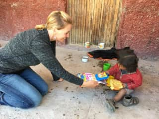 Travel to Peru and gifting items to children in the Andes