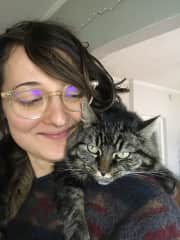 With my cat, Luna. I've had her since she was a kitten, and she loves being draped over my shoulders.