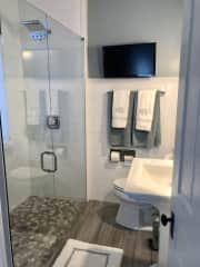 Newly renovated bathroom with rain shower.