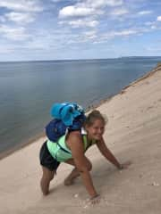 Brigitte climbing a 450 foot sand dune in Michigan, biggest work out in our entire lives haha.