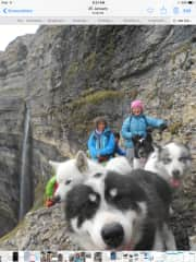 Trekking in Svalbard ( me in pink hat) and Greenland dogs for company