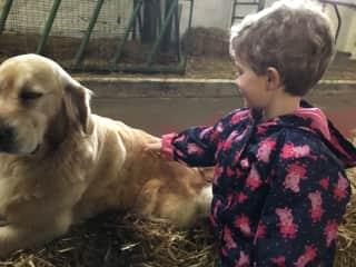 Abigail patting the farm's dog