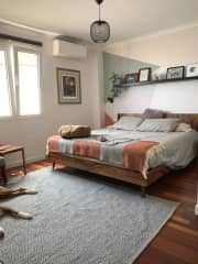 Guest bedroom with King size bed. Plenty of natural light, space, and a private full bathroom.