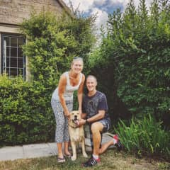 Linda and Nige with the lovable Larkin in the Cotswolds.