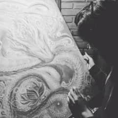 Justina painting her dragon