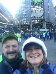 My husband and I at a Seahawks game