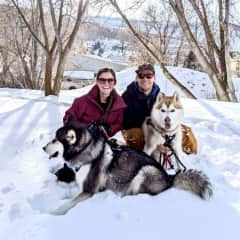 Maria and Isak with Kona (malamute) and Rocky (husky)