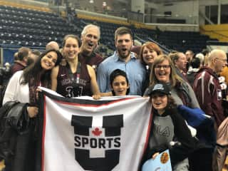 This is Tim and I with Family celebrating our daughter's team, McMaster U,  winning the Canadian Nationals in Mar 2019 - first time in school history.  We love basketball.