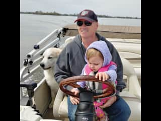 Greg, our granddaughter and Tiny