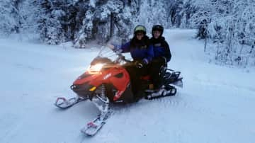 Travel - driving a snow mobile in Finland