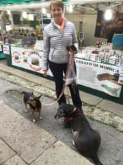 Lacey exploring a seasonal market with Roxie and Biggie
