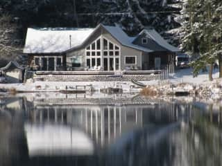 House from the lake in the snow