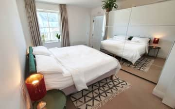 Master bedroom has a super king bed and en suite. There's a second bedroom which is set up as a nursery with a sofa bed.