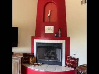 """Gas fireplace to the right of 48"""" LG TV w/DISH and Roku and DVD player."""