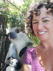 Claire with a very friendly Red Colobus monkey in Zanzibar 2021