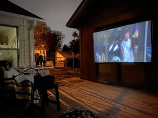 We have a projector for movies in the backyard!