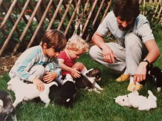 Christophe and his children with the first litter born from one of his own Husky's