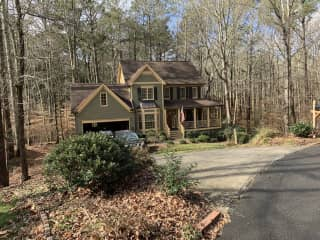 Home located on private 1 acre wooded lot