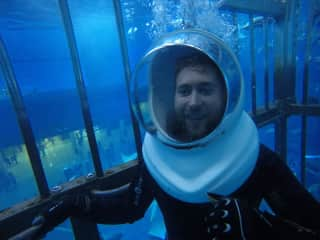 James in a shark cage.