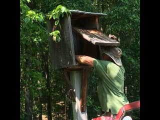 Kip cleaning out Wood Duck boxes on our farm in the spring.