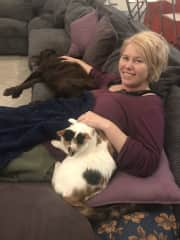 Lisa cuddling with our cat Sparkles and labradoodle Delta