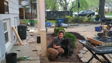Emily w/ 1 of our dogs building columns and doing landscaping