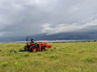 Mowing a new road on our Montana ranch