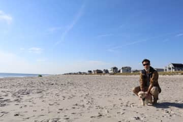Gonzalo with our previous housesitter pup, Khu