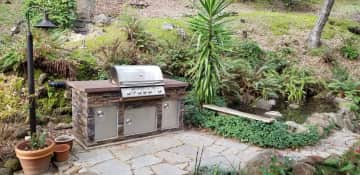 Outdoor grill near the middle pond