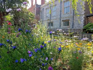 Our garden with Hunstanton Hall across the moat