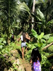 Hiking (barefoot) through the tropical forest in the Philippines