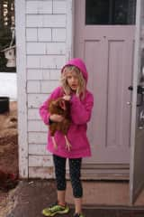 This is Clara holding one of our laying hens