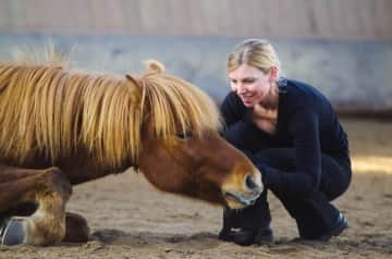 Susanne with Dadri, her icelandic four-legged partner
