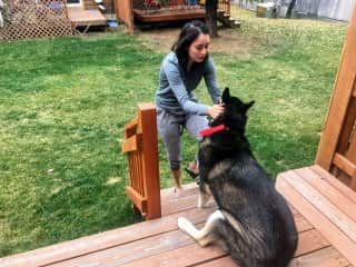 Hannah giving love to our neighbors dog.