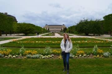 Austen admiring the gardens in Paris, France