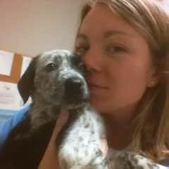 Me snuggling a puppy patient!