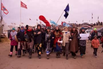 Helping to lead a Women's March at Standing Rock, 2016 (I'm in the sunflower skirt)