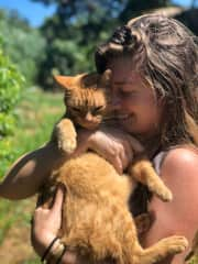 "Me and Milo, my angel of a kitty who ""adopted me"" during my two years living on a farm in Hawaii."