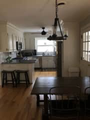 Dining table and kitchen - open plan to living room.