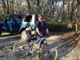 Lincoln on his mountain bike with our Jeep