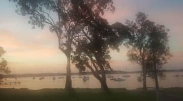 Sunset from our home verander on the shores ofbeautiful Lake Macquirie NSW hard to leave but adventure calls