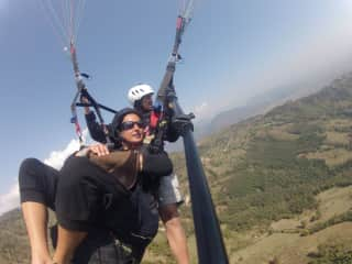 Buddhi and Wendy Paragliding at home in the Himalayan's