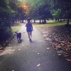 Paige and Eli strolling in the park.