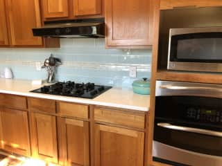 Modern, well stocked kitchen is a delight to cook in.  Also have a gas BBQ on back patio with two outdoor eating areas.