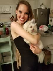This a photo of me with Majorie. She is the cutest little princess. She loves to wear little bows in her hair.