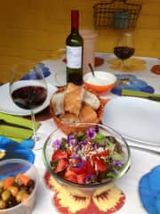 Enjoying home made salad with wine