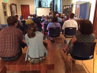 Me reading from my novel at the Nordic Heritage Museum, Seattle