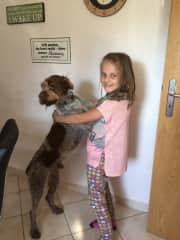 Our dog Filou and my daughter