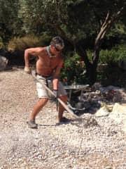 Brett landscaping in a garden in Greece